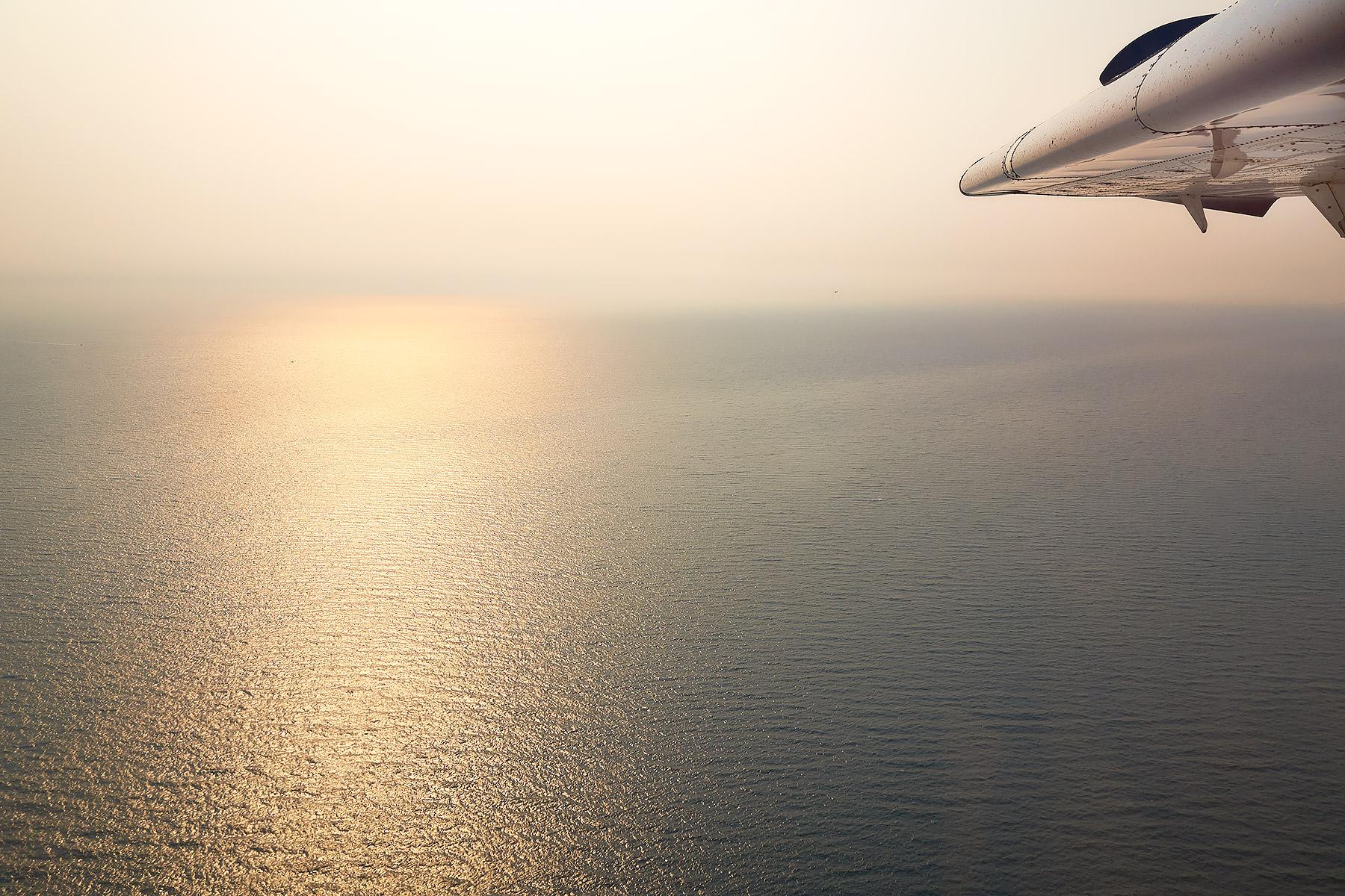 Flying through wildfire smoke above Georgia Strait